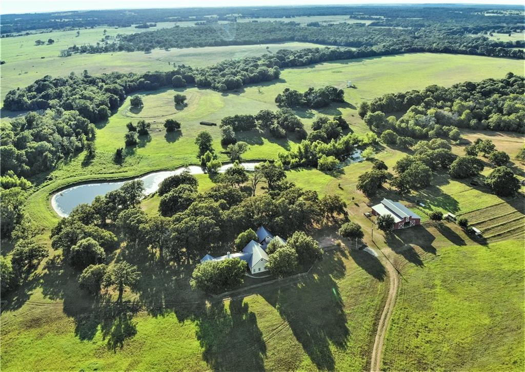Here is an opportunity to own 74 plus acre waterfront ranch in the sought-after Northern Lee County. Ranch house sits atop a hill overlooking the stunning property. Stocked 2+- acre pond plus a second pond. Little brushy creek. Rolling hills, huge oaks, and wildlife. Shop. Detached guest suite with a full bathroom and kitchenette. Outdoor patio. Barn with stalls, office, and hay loft. Pipe pens. Fenced. This ranch offers privacy and freedom, but access to the comforts of being close to town!Guest Accommodations: Yes 