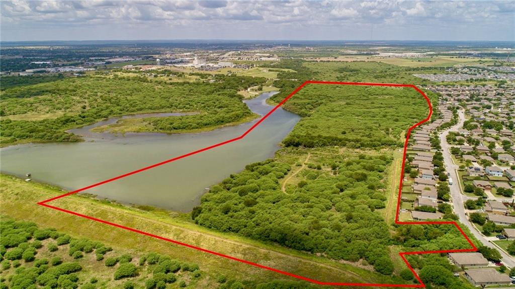Incredible opportunity to own 80 acres in the heart of Kyle just off IH 35 with 960' of frontage on Dacy Lane. This property borders a dammed portion of Plum Creek creating a 20+ acre lake. There is also a smaller 1-acre pond on the property that is secluded and private. A significant portion of the property lies within the 100 year floodplain- see photos for details.
