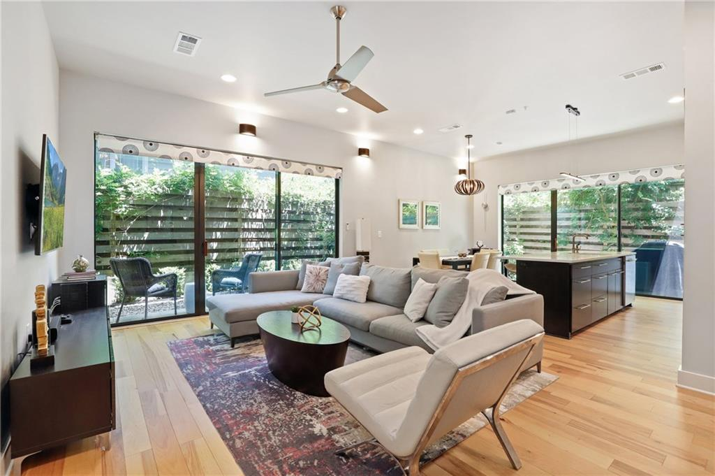Offering the best of both urban & neighborhood living, this Tarrytown condo is just minutes from downtown & walking distance to Lake Austin & Lady Bird Lake hike/bike trail. First floor, back unit with private entrance & backyard which provides outdoor living space & serene atmosphere. Contemporary architecture & sleek high-end finishes featuring tall ceilings, bright open floor plan, hard wood floors & SS appliances. Excellent layout with an efficient use of space w/ all bedrooms containing a full bath.FEMA - Unknown Restrictions: Yes  Sprinkler Sys:Yes