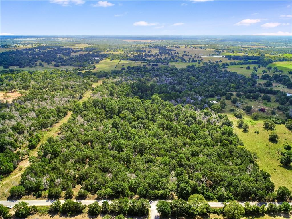 Beautiful ranch with open fields and dense mature trees towards the back of the property. Wet weather creek through the property and dual frontage from FM 2104 and Nink Rd. If you are looking for the ultimate social distancing than this it. Surrounded by large acre tracts and a newly remodeled home on over 135 acres. Home features granite counters throughout, beautiful brick fireplace, dual vanity in the bathroom, wood and hard tile floors and stainless steel appliance package Come see it today!