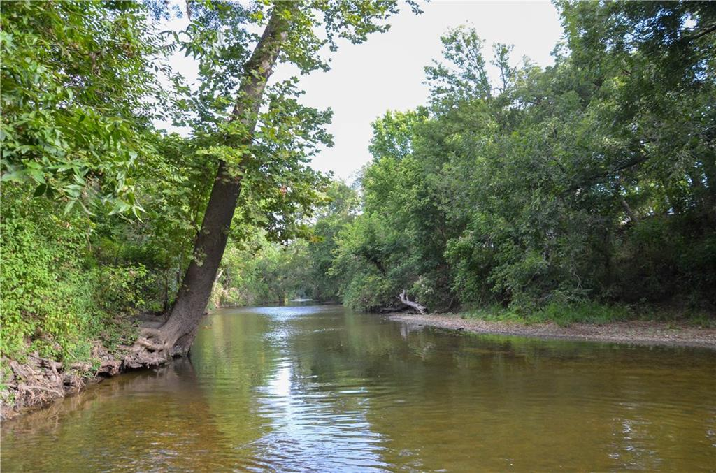Over 100 ft of elevation change from 630' in the front of the property afford long distance views of the surrounding countryside and the hay field on the property. The north boundary of the property is Brushy Creek with +/-2,900 ft of frontage. Slopes to the creek are gentle allowing for easy access to the creek. Tree cover varies from elms and oaks in the uplands to pecans and elms in the valley lining the creek. A tributary feeds two ponds for watering livestock and wildlife.Restrictions: Unknown