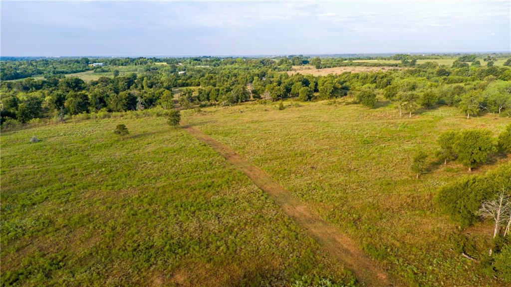 20 ft easement access is approx 850 ft. long. Beautiful land with mature oaks, approx 15 acres with Tipton grass, gentle slope, good terrain! 2 sides fenced, no pond, nice home site, well is needed for water. Beautiful oaks and grassy fields! Appointment required with Realtor to access or view land! Pre-qualification required! Cattle ag exemption in place for ag value and low taxes! Only 15 minutes to Hwy 71! 25 mins to ABIA! No subdividing allowed due to only 20 ft easement! No RV park, etc.