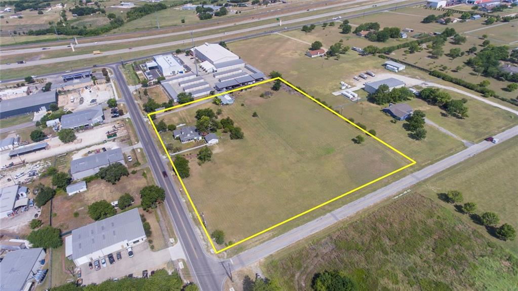 Great flat buildable lot in a high traffic count area. This corner lot is located at the corner of Rowe Ln and Rowe loop a gateway to major residential developments like star ranch, Blackhawk, steed crossing, and more. This is a great opportunity to develop in a fast-growing area between Hutto, Pflugerville, and Round Rock.    The City of Pflugerville has expressed excitement for rezoning this location to bring economic growth and entertainment to the community. The future land use plan (currently) shows this property as an ideal location for medium density. Based on the comprehensive plan and a large number of residential units nearby.? Ideal uses for this location would be Multi-family, Retail, Medical, industrial, & gas station. Seller is open to joint venture on a 1900s village-inspired mix-use development with retail, office, and restaurant users.  Currently, there are two standalone buildings located on-site. The warehouse/office lab space is used for a naturopathic medicine consulting office. Restored 1902 victorian home is owner-occupied but could be used for medical and professional offices, coffee shops, restaurants, etc.  The site currently has water from Manville WSC and septic. With city wastewater, and natural gas at the corner of Rowe ln making all utilities currently on the property.