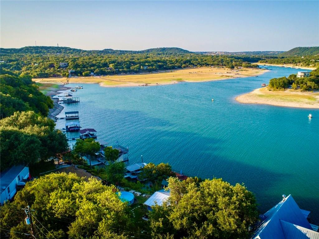 Incredible Lake Travis Waterfront! Adorable lakefront cottage features Lake Travis deep water access with a single slip boat dock already on site. Enjoy amazing views of Lake Travis from the spacious tiered deck. Views from the home are unbelievable and the spacious and level yard allows one to take it all in without obstruction. Carefully maintained landscaping and trees provide the perfect cover and privacy. No HOA and no restrictions, so add-on or rebuild to your liking. Amazing opportunity!FEMA - Unknown Restrictions: Yes