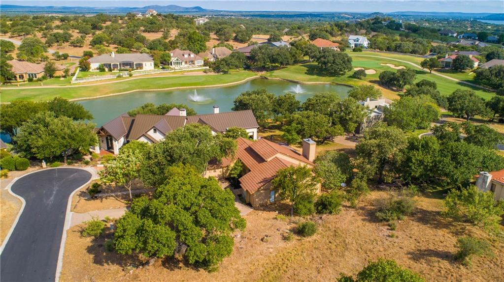 Ready for immediate move-in, this 2/2/2 + study home located in Horseshoe Bay West was completely remodeled in 2017-18. The home has soaring vaulted ceilings, a magnificent travertine fireplace, and beautiful tile floors that are complimented with warm colors that create a welcoming ambiance. The eye-catching kitchen includes granite countertops, a travertine backsplash, and a Kenmore Elite Downdraft Stove. The study off the living room has striking hardwood floors. ** Listing agent is owner principal.