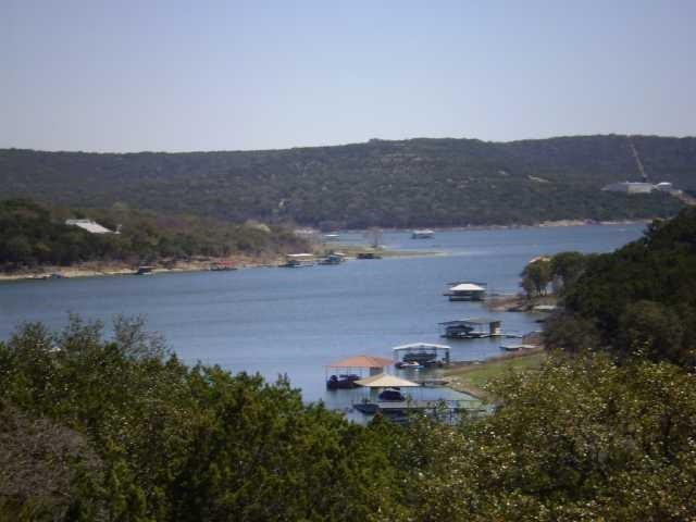 Unrestricted Lake Travis (seasonal) Waterfront property on 3.098 acres with easy access to the water at Jones Brothers Park. No HOA! This area is quickly undergoing a transformation and the area is rapidly appreciating. This is 1 of 3 parcels w/incredible lake/hill country views. The cottage is 592sq.ft, the other parcels are 18203 Gregg Bluff a MH/hybrid home w/1140sq.ft. to the right of the cottage & lot to the left of the cottage at 18113 Gregg Bluff. Uncombined-seasonal waterfront -deeded water rightsGuest Accommodations: Yes