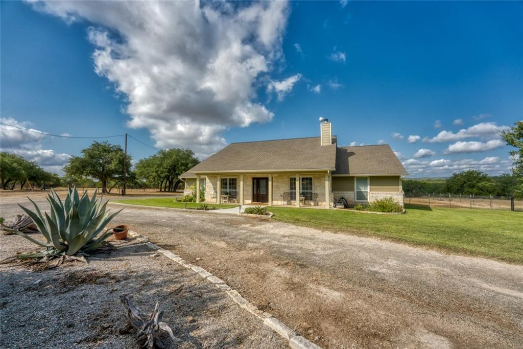Nice 3/2.5/2 rock home in a gated subdivision.  Located mid-way between Johnson City and Marble Falls and less than an hour to Austin.  Also the Baylor Scott & White hospital and clinic is less than 10 minutes away.  This ranch is ready for your horses.  4 stall horse barn with a large paddock.  The acreage is fenced and cross fenced.Restrictions: Yes  Sprinkler Sys:Yes