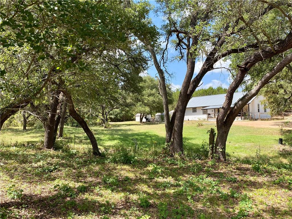Property is 5.84 UNRESTRICTED acres with 3/2 house with no HOA. Prime investment property close to highway 290. Property has tons of possibilities with huge mature trees. Must have an appointment with agent prefer to have 24 hours notice to arrange with tenants.