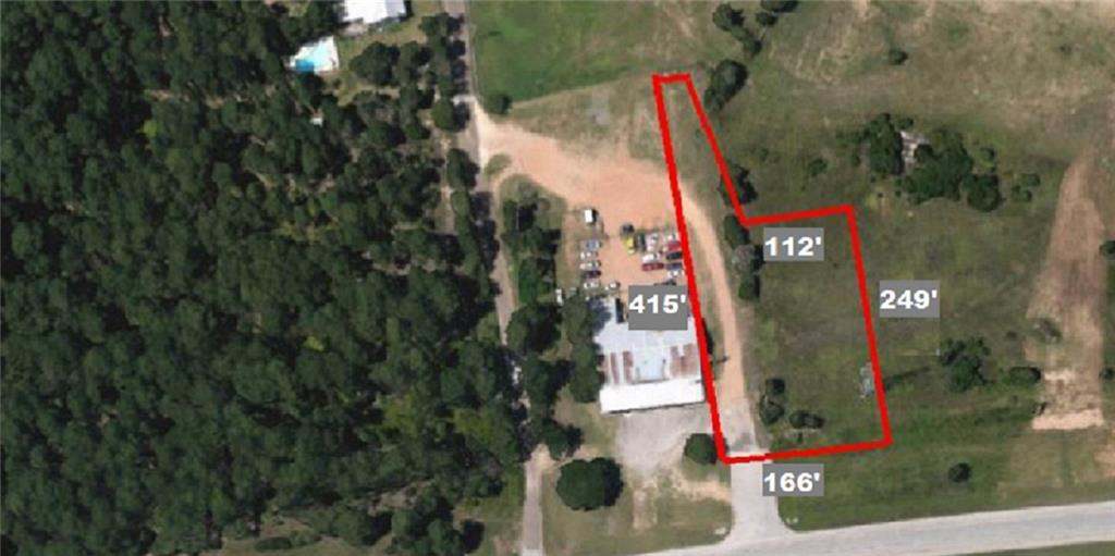Vacant Commercial land- Lot with 166 ft of frontage on Hwy 71 and easement access to Arena Rd. - Build to Suit up to 5500 sq ft of business! Fast food or car wash would go great here - see photos for renderings. Lot located in the fast-growing area of Bastrop. Restrictions: Yes. Water tap at South East Corner of property. Sewer and electricity also in place. Owner is willing to participate in an exchange or participation of build-to-suit or owner financing. C-1 zoning- buyer to verify