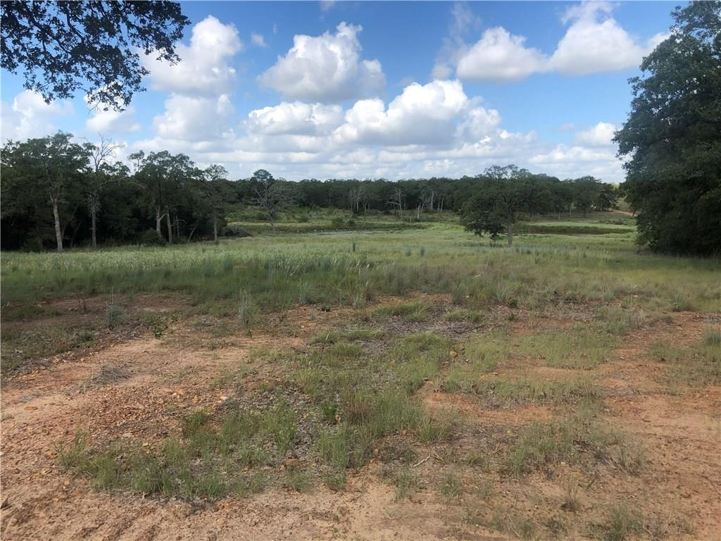 Wonderful acreage near Bastrop Texas is 57.93 acres per survey. Quiet country road, ag exemption, cleared perimeter makes it easy to drive & survey your beautiful wooded property with three ponds. Nice terrain with a hill perfect to build your dream home in quiet seclusion. Includes front nine acres with great ample frontage, metal barn, cool industrial style structure, old well and septic. Property has nice perimeter fence. Approx. 29 acres more adjoining also available.Restrictions: Unknown