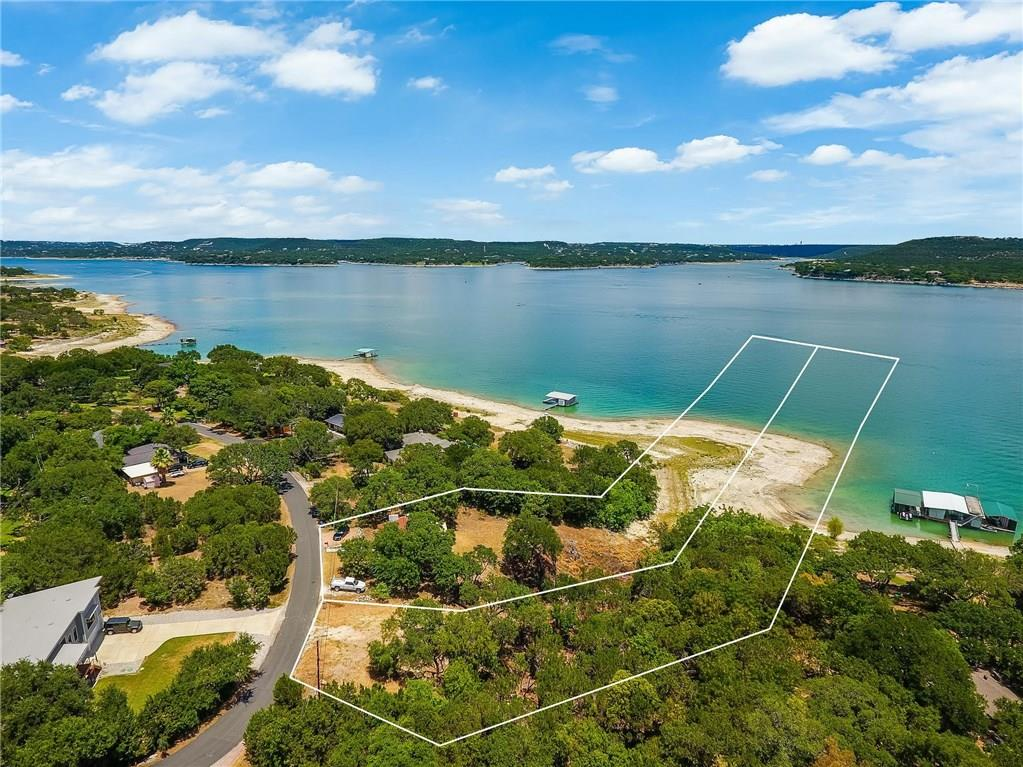 Rare opportunity to own 18+/- acres of waterfront Lake Travis close in to Austin! Located in Travis Landing, this is one of the last waterfront lots left with deeded access to the deepest part of Lake Travis. You will never experience issues with crossing others property to access the waterfront. Boat Docks allowed (per LCRA restrictions). Small 1/1 Lakehouse has been meticulously renovated and is currently occupied with a tenant. Lake Travis ISD - close to Steiner Ranch & Lakeway!Restrictions: Yes