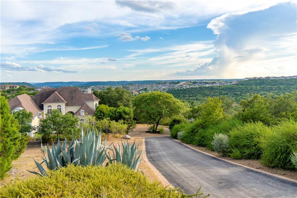 Come home to your own oasis with almost 5 acres of privacy!!!  A rare find in a master planned community.  Enjoy the views from both floors of the hill country and relax by the negative edge pool.  Tons of space inside and out for everyone.  Office, game/flex room, media room and exercise/bonus room. New carpet, and partial interior paint. If peace and privacy is the goal, this is the home.Restrictions: Yes  Sprinkler Sys:Yes