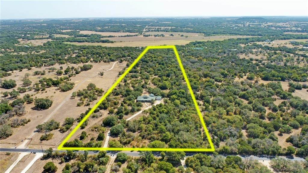 23.9 acres with a stunning 4 bd, 3 bath custom home in Liberty Hill ISD. The east boundary has a high bluff overlooking the San Gabriel River, which offers amazing hill country views, perfect for a potential 2nd home location. The property is heavily wooded and intentionally left natural for hunting and maintaining a wildlife exemption. Lightly restricted and can possibly be subdivided in to smaller lots. The ranch style home has a fire sprinkler system, gourmet kitchen, wrap around porches and much more!Restrictions: Yes