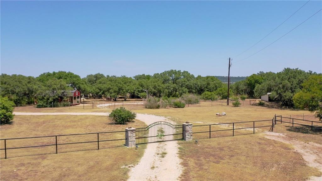"This Hill Country retreat provides outstanding recreation & hunting opportunities. Over 200ft elevation change. Dense hardwood cover (very little cedar).  Improvements include a barndominium w/1,600SF of living area plus 1,400SF of barn space. A separate barn provides another 1,775SF. This ranch is being sold ""turnkey"" & includes furniture & top of the line feeders & blinds. Just a few min. from Burnet.