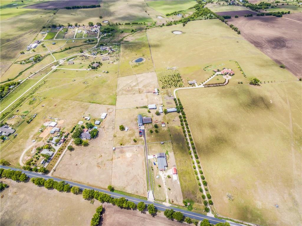 Get a Ranch!  This property includes a huge house that sits on 1 acres plus ag exempt back part that is about 18 acres. Office plus 5 bedrooms! The front right acre is not included.  Refer to PID #0275800108 which is part of this sale.