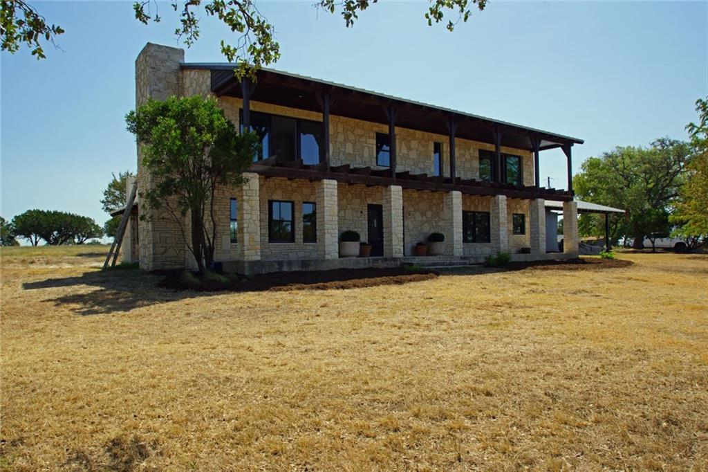 "19.62 UNRESTRICTED, ag exempt acres with a stunning 3515 sf custom stone home on scenic Creek Rd in Dripping Springs. Amazing hill country views from all areas of the property. Although still under construction this unique, completely renovated home features substantial interior & exterior stone work, exposed beams, 3 fireplaces, outside kitchen, covered porches & balconies, spray foam and the list goes on! First floor bedroom can be a guest suite or 2nd primary bedroom. Second floor office can be a 4th bedroom. Large, oversized carport hold several vehicles and ranch toys. The property also has numerous large, mature oaks, pecan trees, abundant wildlife, out buildings and pens. Topo is level to sloping. Dripping Springs ISD. List price includes a fully completed, move-in ready home or buy ""as is"" at a discount and finish the way you want. Possible uses include: Luxury Estate, Venue, Event Center, Rehab, Rental, Vineyard. An adjacent 20 acre tract is also available."
