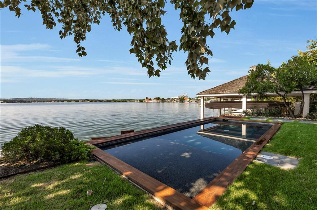 LAKEFRONT SANCTUARY awaiting your arrival! Positioned with a southeast exposure to take full advantage of lake breezes andnatural sunlight, this well-designed waterfront home offers a seamless flow between indoors and outdoors, ideal for entertaining. Fivecomfortably sized bedroom suites, each with their own ensuite bath, is ideal for entertaining large gatherings of family and friends.FEMA - Unknown Restrictions: Yes