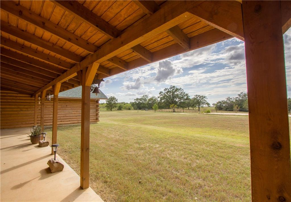 """UNRESTRICTED AG EXEMPT  - PRIVATE 31 Ac Custom 6"""" Log Home. Covered Front/Back Porches include swings. Hunting Blinds convey, Tree House Blind, Pond, Wood Burning Fireplace w/6' CMU Firewall, Masonry Chimney. All Electric,  All wiring 12 Gauge, 20 Amp Breakers, 5 Ton HVAC Unit.  13' Tall Vaulted Ceiling in Great Room w/Cedar Beams, 10' Vaulted Ceiling in Master BR, Real Wood Laminate glued down flooring and Slate flooring.  Solid Alder Wood Interior Doors. Formal Dining orig designed for 3rd BR."""