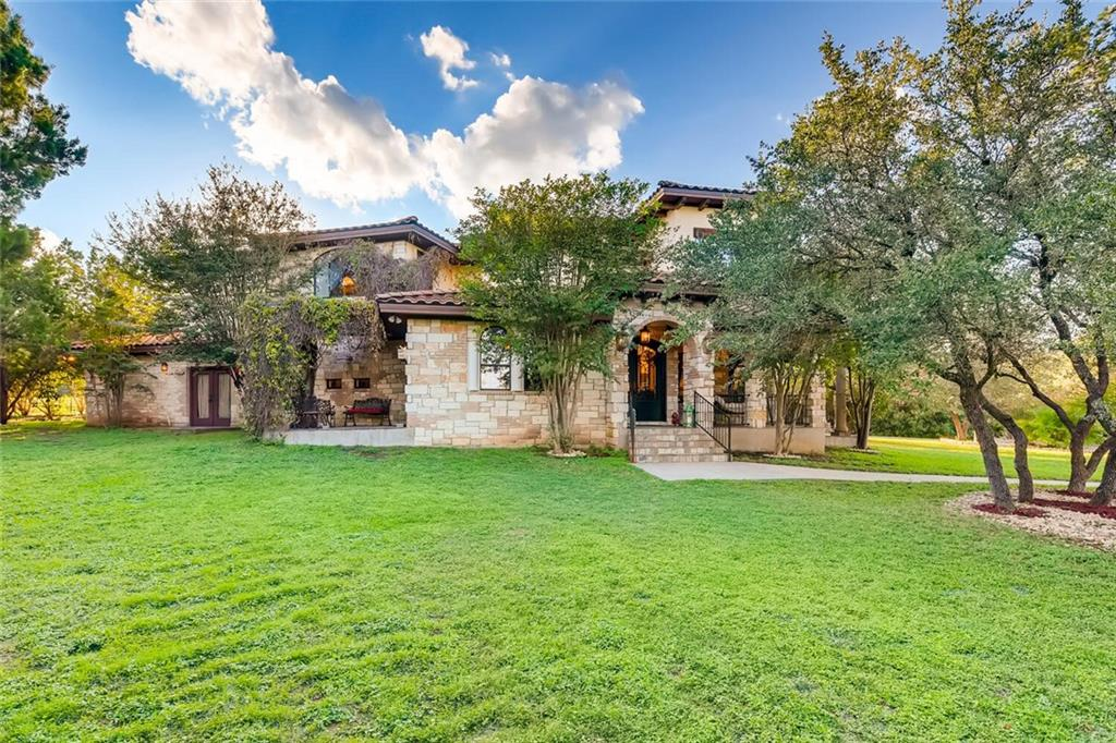 This custom home has it all.  A private and gated community with a hill country feel, large lot, abundant space, 4 patios, separate office, craft room/second office/classroom, Jack & Jill bathroom, walk in his/hers closets in master bedroom, Pecan cabinets throughout, circular wood staircase with custom wrought iron railings, close proximity to Lake Travis and 2 miles to Jones Brothers Park.Restrictions: Yes  Sprinkler Sys:Yes