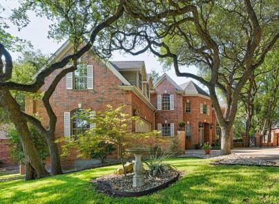 Beautiful brick home surrounded by huge oak trees on cul-de-sac within walking distance to Forest Creek Elementary.  3600 plus sq. ft. per appraisal!  Amazing foyer with curved staircase and soaring ceilings.  Guest bedroom and full bath down with all other bedrooms up.  Hardwood floors, crown molding, wood blinds, tons of windows and much more--recent tile and backsplash in kitchen, recent interior paint, recent dishwasher, recent double oven.