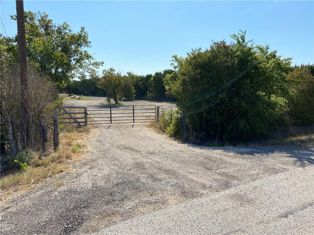 Great opportuntiy for someone that wants 4 acres close to town without the HOA, or Restrictions.  Just minutes from Ronald Reagan and Andice.  Build your dream home or your business, there are no restrictions. Trees line the entire property line for added privacy. Property currently leased until the end of September