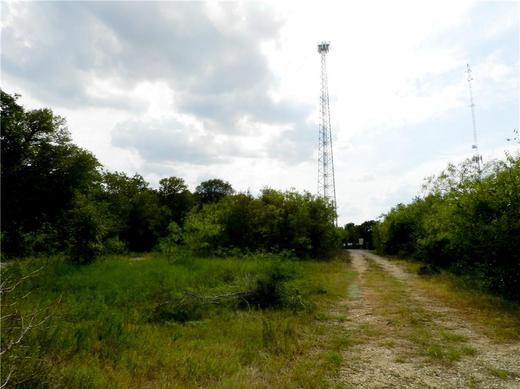 Unrestricted, 32 Acres, Commercial / Residential Development Opp in Western Bastrop County, $26k/a, near to Bluebonnet Elementary School & The Colony Subdivision, Existing Cell Tower Lease in Place only takes up a VERY small amount of the acreage. Architectural Site Plan forthcoming...