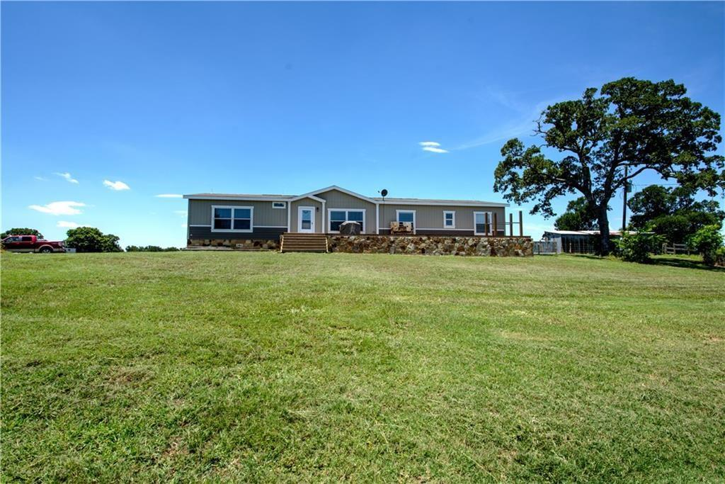 If country living close to town is what you are looking for, then you do not want to miss this place! 31.21 ac inc. improved pastures, hay barn, equipment/horse barn, storage shed w/dual loft storage, feed/tack room, partial wood fencing, & 2432 sq ft manufactured home w/upgrades. 4 bed/2 bath inc. game room, kitchen, den/family room, pantry, utility room, 2 in. closed cell spray foam insulation to preserve flooring, stone skirting & extra beam support, and front & back decks. Great for horses & cattle!