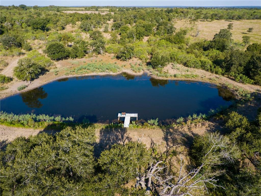 Beautiful oak trees, nice pond! This land is gorgeous, located 2 minutes from FM 20 and FM 535 for a 35 min commute to Austin. There is an easement through this tract to access the back 31 acres, the 31 acres is also for sale! Beautiful home sites! No RV park, no subdividing, no commercial!