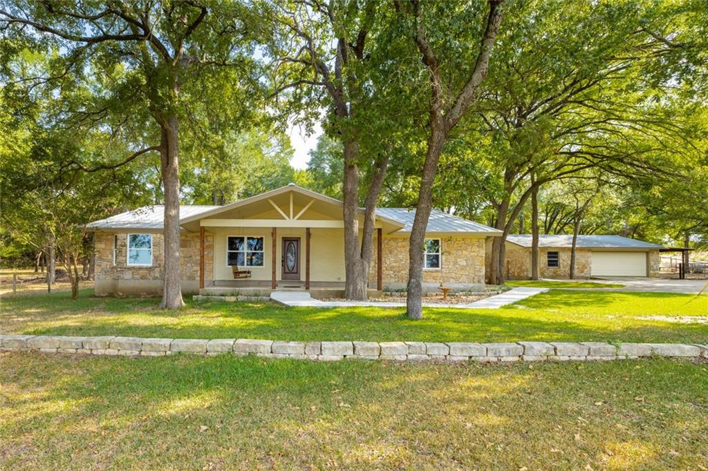 7.48 beautifully wooded & pasture acres (2 tracts)  across from South San Gabriel River. 2588 sq ft remodeled custom built home,w/many upgrades including vinyl windows, new standing seam metal roof & much more w/ detached garage both w/stone exterior. Build 2nd home on other tract, 30' by 50' barn. St.David's Emergency, Leander ACC, new Leander Northline Development all 1+mile. Capitol Metro Rail & Bus & HEB 2+ miles. The new 183A extension will be convenient when completed.Restrictions: Yes