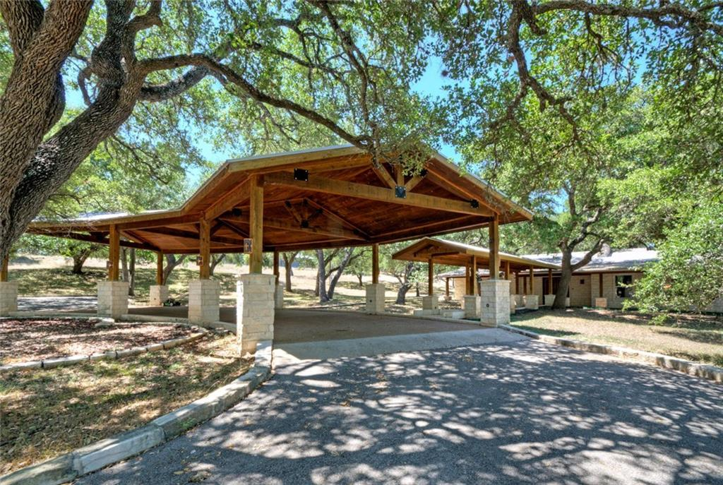 This 7.79 ac luxurious, artistic, Texas Hill Country estate was created by Artisans and Master Craftsman from Texas, New Mexico and Germany. Abundant mature, native Live Oaks surround the home, the over-sized Porte Cochere and covered walkways. Features include Venetian plaster walls & ceilings, solid knotty alder doors & cabinets, gourmet kitchen w/ Viking range, stainless appliances, gorgeous expanses of travertine tile, tile mosaics, inlays, hardwood and slate flooring, 4 fireplaces, an amazing custom library, a stunning Primary Suite, large shaded Trex deck, hot tub, climate controlled dog kennel, well house, propane building and much more! The property is also UNRESTRICTED and AG EXEMPT.