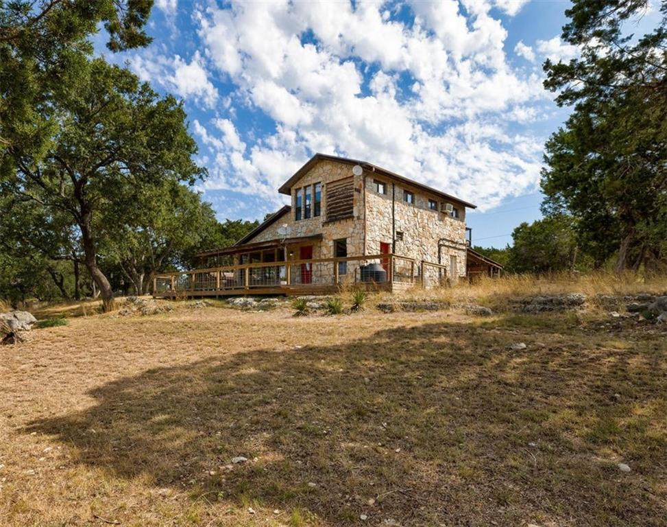 Get away to this lovely cabin located on 10 acres, a stones throw from Hamilton Pool AND in DSISD! Enjoy the stunning panoramic view of the Hill County on the huge deck and see the nightly deer parade. This farmhouse styled home is 1,800 sf with large open kitchen/LR. Property has multiple storage buildings. This unique property is private and is low maint care but also with low restrictions for making it your own, bring your chickens. Close to Johnson City, Austin, & Lakeway. Washer/dryer/fridge convey.Restrictions: Yes