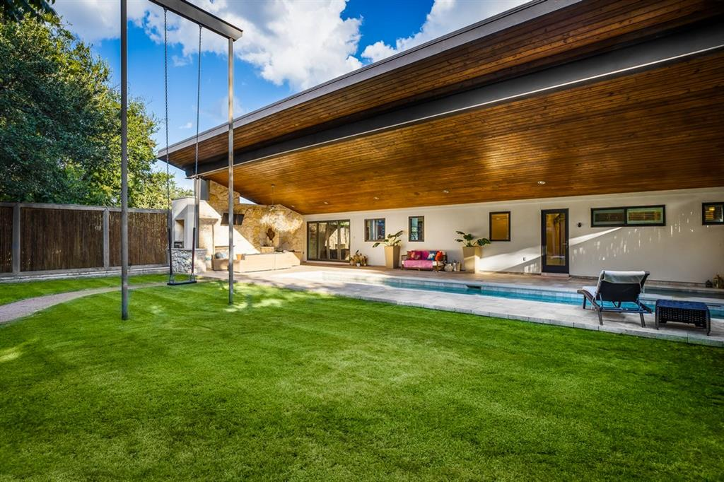 A light-filled contemporary home w/views of UT, the Capitol & downtown skyline through lovely, mature oaks. This Dick Clark design features a stunning butterfly roof, allowing the ceilings to soar in the living room & kitchen. The back of the roof shades a lap pool & spa, outdoor living, flat yard & sculpture swing. Downstairs is the guest suite w/ private entrance, 3rd bed & bath, plus a bonus room or 4th bed. A short stroll to Russell's Bakery; minutes to Mopac & equal distant to the Domain & Downtown.Guest Accommodations: Yes Restrictions: Yes  Sprinkler Sys:Yes