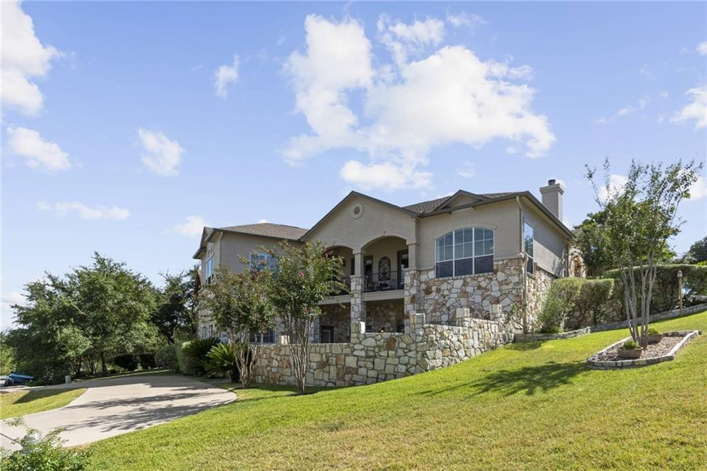 Located on the side of one of Lakeway's highest hills this beautifully finished home offers panoramic Hill Country views from the main level, Lake Travis can be seen in the distance. It is on a corner lot/hill, with garage on main level & circular drive on lower level. There is a kitchen & laundry connections on both levels, perfect for multi-generation needs. Beautifully finished open floor plan with lots of natural light. The exterior offers a balcony & gorgeous courtyard. Must see! Owners are listing broker/agent. Golf course community. Sprinkler Sys:Yes