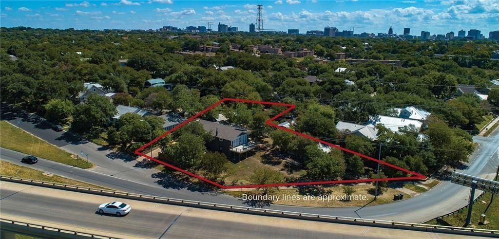 Value is in the LAND! Rare opportunity to own almost half an acre off West 6th St.   Zoned MF4 - can build up to 15,000 of improved space (buyer agent to verify).