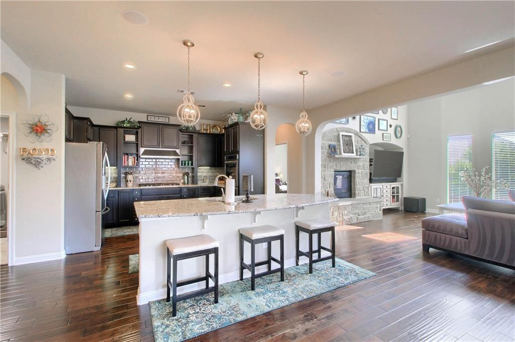 Elegant large home in Paloma Lake. 2 Community pools and splash pads. Hiking & biking trails, shaded community playground. 3,584 sq.ft. 4/3.5/2, large Office, Game Room w/5.1 Surround Sound, 1 Bedroom used as a media room w/7.1 Surround Sound, Master Bath w/walk-in shower & garden tub. Double height bay windows in Family Room, Gourmet Kitchen w/5 burner gas cooktop & double oven, covered patio w/rough-ins & speakers, 2.5 car garage with built-in storage. Large Utility Room w/cabinets! THIS IS A MUST SEE! Sprinkler Sys:Yes