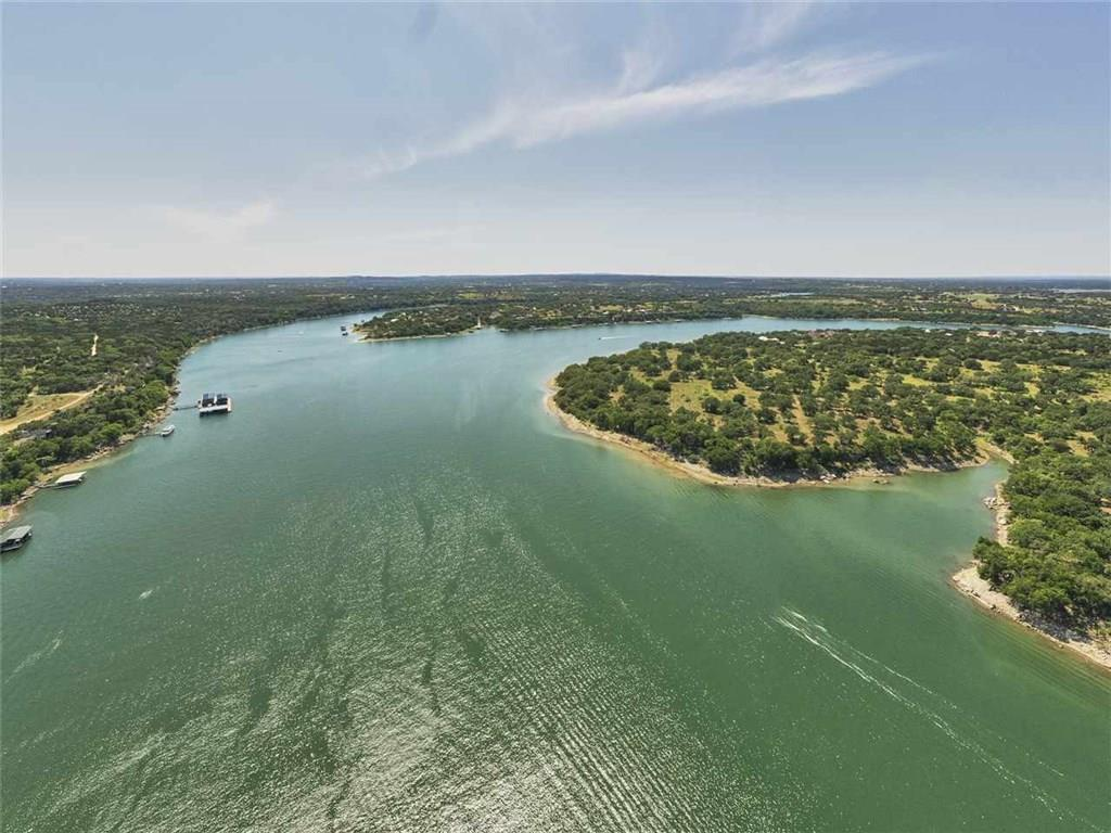 Spectacular 30+ ac property w/ approx 700 ft of Lake Travis waterfront. Located at convergence of the Colorado and Pedernales Rivers, the water is deep and consistent. Several great building sites with stunning SE facing views of lake under canopy of large majestic Oaks. Access to property is through a gated subdivision on ribbon-curbed paved road. Abundant wildlife include whitetail, turkey, dove, songbirds, etc. Wildlife Valuation currently in place keeping taxes low. Livestock and bow hunting allowed.Restrictions: Yes