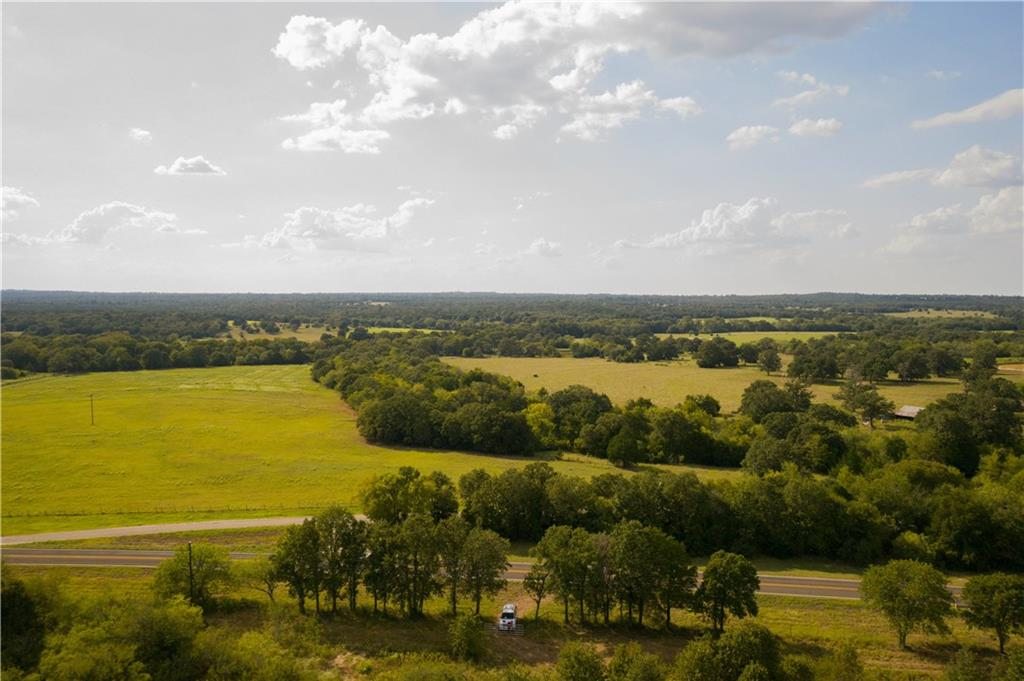 13.5 acres of ag exempt property ready for you and all of your adventures! Aqua water line available along the road and bluebonnet electric line runs along the road as well. Mature oak trees are scattered about the property as you go across the rolling land scape. Come build your dream home or whatever you desire. Adjoining 13.5 acres is also available.Restrictions: Yes