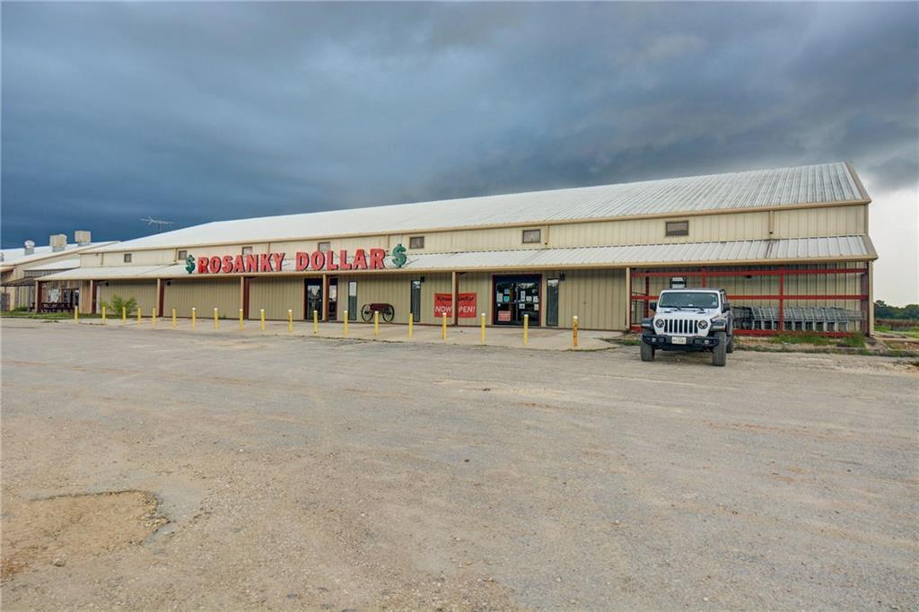 Highly visible 11+ acres with 18288' metal building. Currently operating as 'Rosanky Dollar' Varity Store. Can purchase building only for $1,499,900. 8 Acres of pasture,could make this a grand Equestrian Center, Living area in barn is ready to go! Great proximity to I-10 for easy access to San Antonio and Houston. Desireable location for many business oppertunities such distribution center, Livestock barn, Feed store which it was in the past.