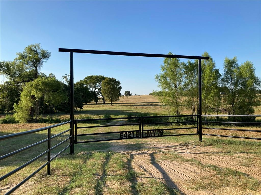 GREAT LITTLE PROPERTY BETWEEN ROCKDALE AND MILANO! LOOK FOR THE CUSTOM IRON ENTRY GATE!  ROLLING PASTURE COVERED WITH WONDERFUL GRASS.  GREAT PLACE ON THE BACKSIDE FOR YOUR HOME SWEET HOME OR WEEKEND GETAWAY. THIS PROPERTY OVERLOOKS SOME VERY PEACEFUL WATER KNOW AS BETCHAN LAKE! DRONE LINK https://youtu.be/zc6VMXLWtrU