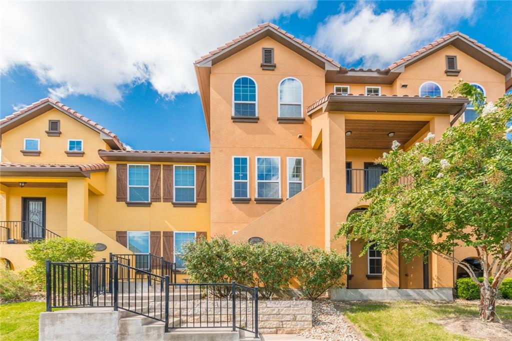 Pristinely cared for condo in beautiful, gated Versante Canyon community. Bright & spacious tri-level unit with master and guest bedroom on 3rd level - both with attached baths and walk-in closets, and a HUGE 3rd bedroom and full bath on ground level (great for guests, office or home theater). Spacious kitchen, living & flex room on main - perfect for 2nd living, office or dining room, with balcony off living area for enjoying those warm summer nights. Stunning kitchen with marble, tons of cabinet space, hand scraped hardwoods, large pantry & 1/2 bath. Additional features include tankless H2O, 3 zone HVAC, Berber carpet, easy ingress/egress at traffic light, wired for surround & attic storage. Fabulous 620 location near the Movie House & Eatery, restaurants, Lake Travis, plus easy access to 2222, 45 or 183. Don't miss all the community amenities including clubhouse, private walking trails, pool, & fitness center! Great schools at Leander ISD - you'll love it here.