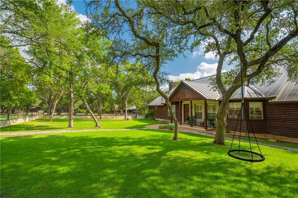 57.65 Acres located between Dripping Springs and Wimberley with a private well cared for main home, guest home, detached garage with apartment, barn, pool and relaxing screened in porch with fireplace. The main home which was extensively remodeled in 2014 is 5 bedroom 2 and a half bath 1 car garage with mesquite wood floors, high ceilings, fireplace, standing seam metal roof and private screened in porch with fireplace.  The master suite has a double sided fireplace and large patio area overlooking  pool.FEMA - Unknown Guest Accommodations: Yes  Sprinkler Sys:Yes