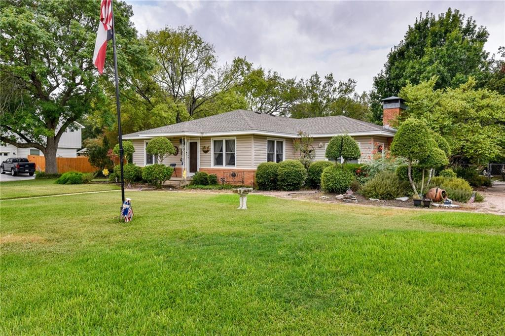 Wonderful Mid-Century Home w/ Detached garage/workshop on 1/2 acre Lot! Lots of living space w/ additional Family area , Wood laminate flooring recently added, original hardwood floors in bedrooms/hallway, Fireplace in Family room, Custom Kitchen Cabinets, Double pane windows, Shingles replaced in 2019.  Nice Secluded and Shady backyard w/ covered patio and additional pergola patio. Workshop has Full bath and AC. Over-sized Driveway is perfect for RV and/or Boat. 2 separate water meters, 1 RV hook up.Restrictions: Yes  Sprinkler Sys:Yes