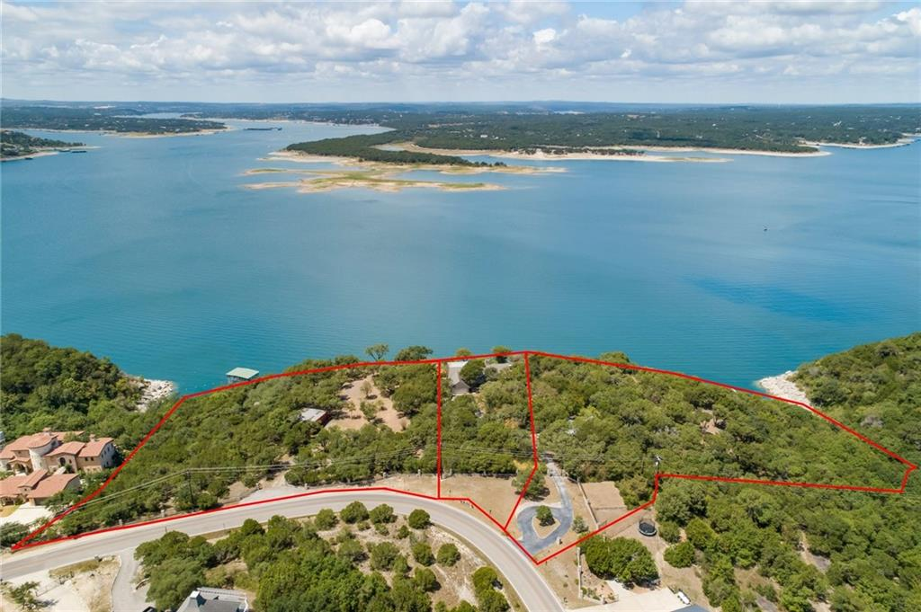 This once-in-a-lifetime opportunity consists of three tracts comprising nearly 8.5 acres over Lake Travis with cliffside water views curving north and south and Arkansas Bend State Park directly across. With 910' +/- of lakefront this site offers both the drama of the hillside perch and water access. Includes a timber-and-stone cottage built in the 1930s, a red barn large enough to store mini-yacht and large two-bay boat garage. 24hr advance showing notice. Boat dock does not convey.Guest Accommodations: Yes