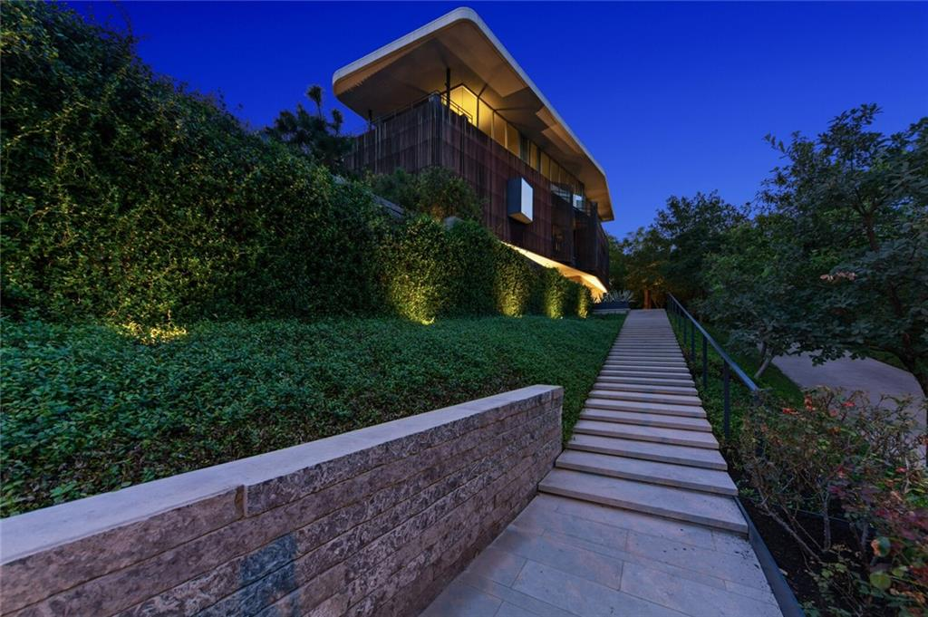 Award-winning modern masterpiece in the heart of Austin. Walk to Shoal Creek & minutes to downtown.  Upside-down floorplan w/elevator gives living/kitchen/master treetop & city views.  Stunning architecture w/bespoke details everywhere, Brazilian cherry floors, burled walnut cabinets, Lueders limestone, ebonized oak, indoor fountain, porthole windows.  Covered patio, outdoor fireplace niche, level lawn. Throughout the home you will find incredible architectural detail and the finest finishes.  Floors of Brazilian cherry contrast with bespoke burled walnut cabinetry in the kitchen and bedroom.  The limestone exterior is echoed inside in the library and porthole-lit master bath featuring a large freestanding tub.  Cabinetry throughout is exceptionally crafted and thoughtfully designed to provide maximum convenience and storage. This is an opportunity to live in the middle of everything, in a home that will be a design icon for years to come!