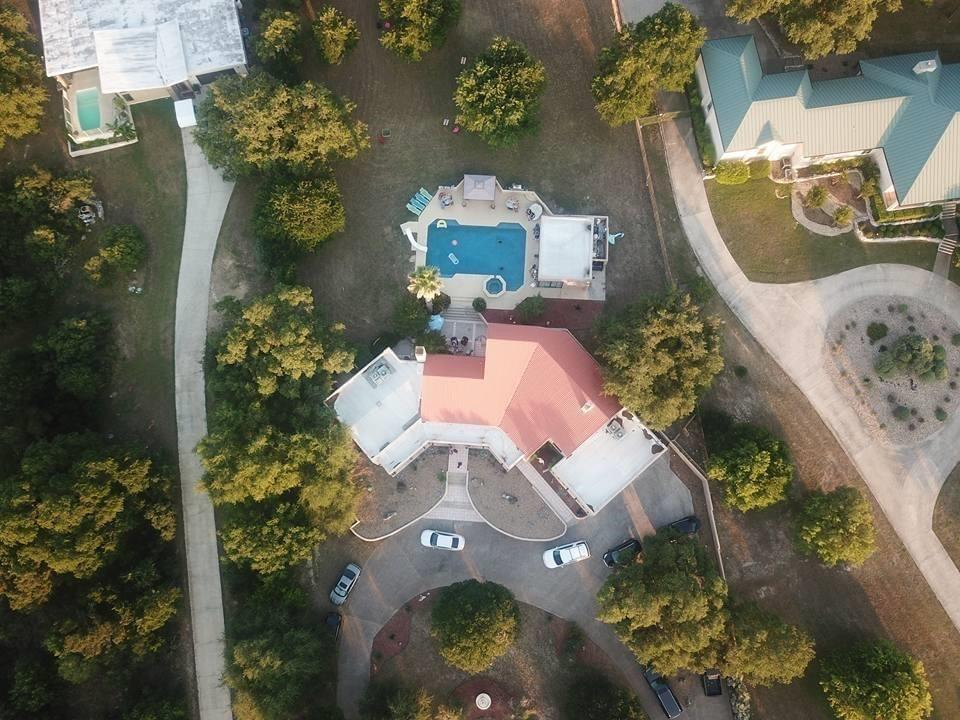 Beautiful sprawling Hacienda style home nestled in a quiet hidden neighborhood in San Marcos. You walk into a welcoming glass mosaic rotunda. Ceramic floors throughout. Tons of natural light. Pine ceilings in family room and master. Glass staircase off the kitchen that leads to the upstairs. Off the game room has a spiral staircase that leads to a backyard oasis. Backyard has a pool house with granite bar. A huge newly renovated pool with Jaccuzi. Circular driveway can fit up to 20 cars.Restrictions: Yes  Sprinkler Sys:Yes