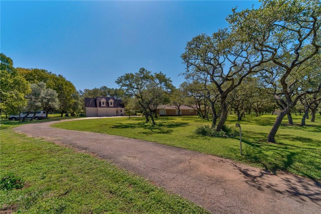 Fantastic country living on 5 gorgeous acres surrounded by canopies of majestic oak trees! Perfect ranch-style home with nearly 3,000 SF of living space, huge Owner's Suite with 4 closets, ensuite Owner's spa, oversized family room w/ fireplace, gourmet Cook's kitchen & more. Private 750 SF guest house, workshop & additional 3 car garage. Gated front entrance for your privacy, lovely koi pond with fountains and so much more! Enjoy the wildlife, the butterflies, the gardens and the beauty of country living!