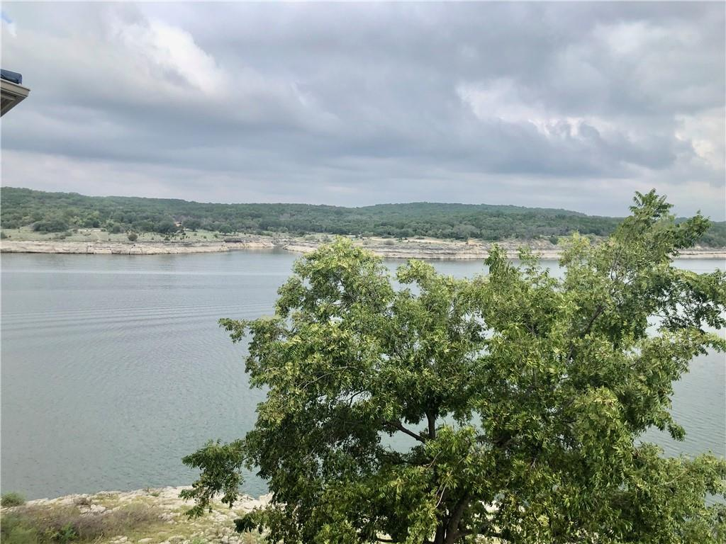 Waterfront resort living at its very best. Owner chose this property knowing this it is the best location of all, covered patio, no direct sun, outstanding views of Lake Travis & within steps of the marina.Exceptionally decorated and in excellent condition. Three bedrooms, 2 baths with double vanities, & granite counters. Master bedroom & living area both have fireplaces. Kitchen has stainless appliances.   Unit next door just sold so there is only one three bedroom available.