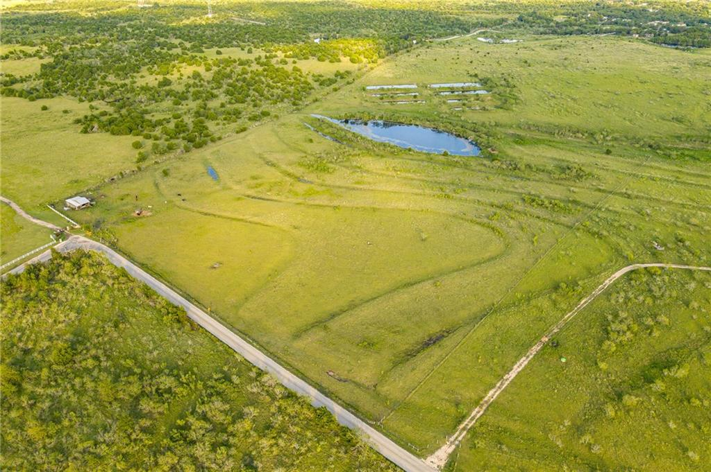 Call first, active grazing lease with cattle on land (cows and bull) preference is to have livestock owner on sight when touring. Sunrises and sunsets to die for! 22.5 acres of rolling land with wonderful views to the north, east and west..complete with fish filled pond. Easy access to I35, 45E, and Hwy 130. Ideal for residence or investment property. Cattle shelter conveys, all other equipment belongs to leasee and is excluded from sale. Goforth Special Utility District water on property. Buyer to validate all information.