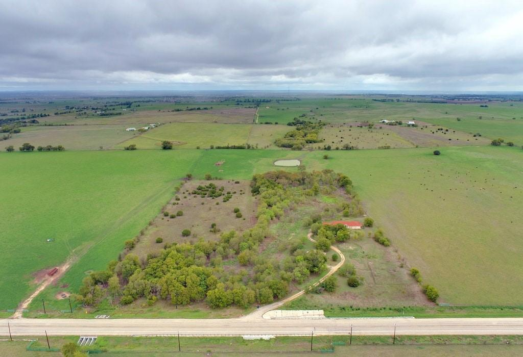 15+ tree covered acres, surrounded by acres and acres of undeveloped land. Two custom homes nestled among the trees.