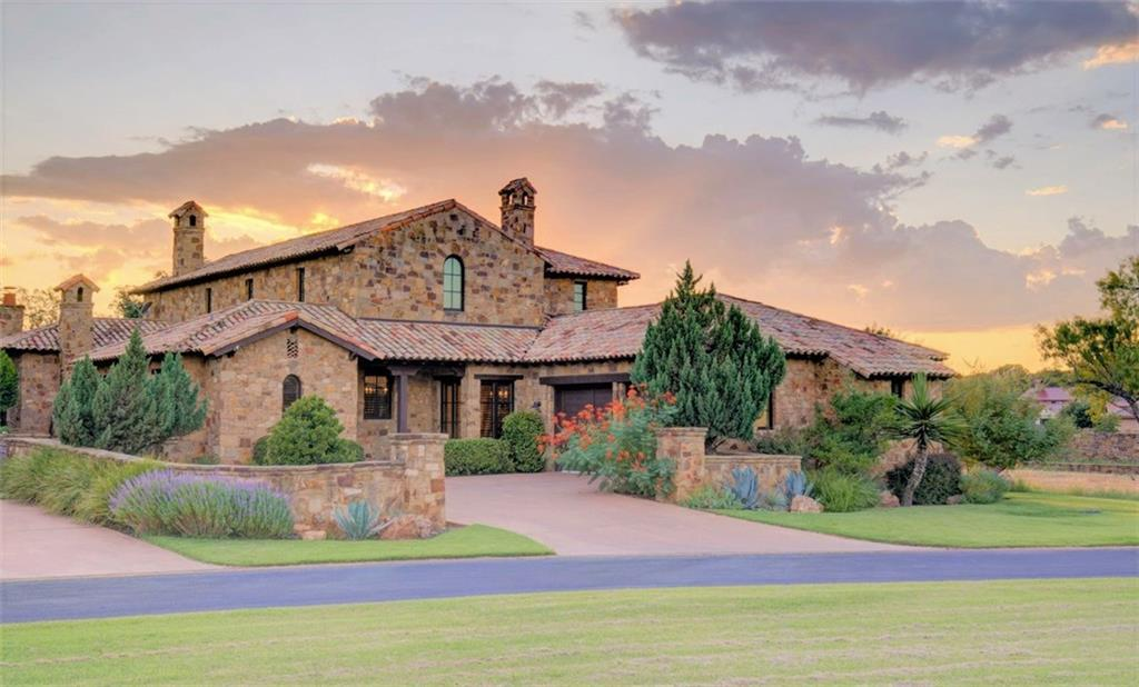 When only the best will do, but incredible value is still a prime concern: LOWEST PRICE PER SF (even below tax appraised value!) IN THE EXCEPTIONAL ESCONDIDO GOLF & LAKE CLUB on Lake LBJ.  Don't miss your chance to own a part of this premier award-winning 350-acre, 18-hole Tom Fazio golf course, ranked as one of the finest golf communities in Texas! Surrounded by luxury & first class amenities at your fingertips, experience the ultimate in entertaining in this RECENTLY UPDATED warm & romantic Tuscan villa, blending Mediterranean elegance with a casual lifestyle. Featuring a cobble stone courtyard, wrought iron & wooden doors, terra cotta roof, private guest casita, lovely courtyard & huge covered patio with wood burning fireplace, 5BR, each with its own ensuite bath, soaring beamed ceilings, rustic wood floors, FIVE fireplaces,  wrought iron fixtures, & so much more! On cold, rainy days, play the likes of Pebble Beach, Augusta & other favorite golf courses in the amazing golf simulator room (coming soon!) Gourmet chefs will love the Wolf 6-burner gas stove, built-in Sub-Zero refrigerator, stainless wine cooler, large walk-in pantry, hammered copper sink & huge island with breakfast bar. Experience the Escondido resort lifestyle by pampering yourself & your guests with the extensive Escondido concierge services, including preparing your home for arrival, valet parking, world class dining in multiple restaurants, luxurious pool & cabana service at the Lake Club, watercraft rentals, playing a round of no Tee-Time golf on the top-rated Fazio golf course, or getting fit in the state of the art fitness center. Or, when not enjoying this beautiful home yourself, offset your investment by putting this much-requested 5BR/5.5BA luxury property into the premier Escondido Short-Term Rental pool.  SOLD FULLY FURNISHED w/few exceptions. Full equity golf membership conveys with approved offer.